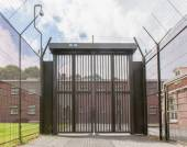 Large gate at an old jail — Stock Photo