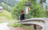 LENK, SWITZERLAND - JULY 23, 2015: Young woman checking the time — Stock Photo