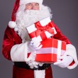 Happy Santa Claus with giftboxes — Stock Photo #57843767