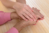 Old and young hands — Stock Photo