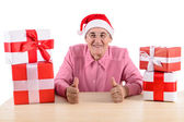 Old woman with gift boxes — Stock Photo