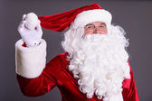 Santa Claus shows hat — Stock Photo