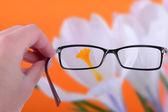 Reading eyeglasses in hand — Stock Photo