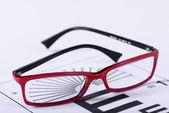 Eyeglasses and eye chart — Stock Photo
