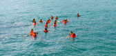 A group of tourists snorkeling on blue sea water in the tropical — Foto de Stock