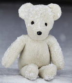 Stuffed animal toy teddy bear in winter snow — Stock Photo
