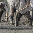 Closeup of construction crew working in concrete — Stock Photo #62747645
