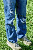 Torn pants in the park — Stock Photo