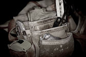 Rugged worn leather carpenters work bags with construction tools — Stock Photo