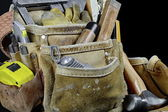 Closeup of rugged worn leather carpenters work bags with constru — Stock Photo