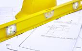 Blueprints with Hard Hat and Level — 图库照片