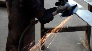 Steel worker and grinding wheel — Stock Video
