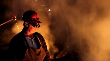 Worker with safety goggles in a foundry — Stock Video