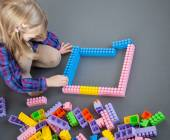 Little girl constructing with construction set — Stock Photo