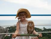 Girl holding a stick with tame owl — Stock Photo