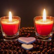 Two small burning candleson — Stock Photo #64752005