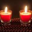 Two small burning candles — Stock Photo #64752009
