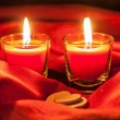 Two small burning candles and white hearts — Stock Photo #64752021