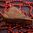 Wooden heart on red beads — Stock Photo #64752111