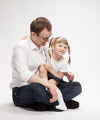 Happy young father with his smiling daughter — Stock Photo