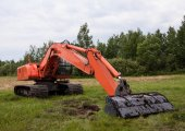Excavator working  on a field — Stock Photo