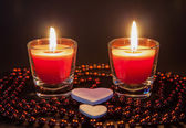 Two small burning candleson  — Stock Photo