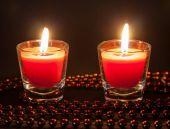 Two small burning candles — Stock Photo
