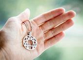 Hand holding symbol of enneagramma — Stock Photo