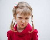 Portrait of a frowning little girl — Stock Photo