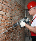 House-builder in uniform with a tape-line — Stock Photo