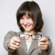 Smiling young woman offering glasses — Stock Photo #68352947