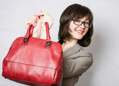 Beautiful young woman holding red bag — Foto de Stock