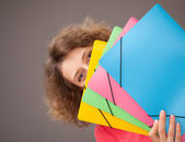 Young woman holding bright folders — Stock Photo