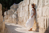 Woman resting by the stone wall — Stock Photo