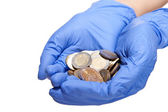 Hands holding coins — Stock Photo
