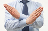 Businessman demonstrating a gesture of a rejection — Stock Photo