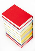 Colorful stacked books on neutral background — Stock Photo