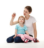 Mother teaching her daughter — Stock Photo