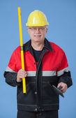 Builder holding a level and a trowel — Stock Photo
