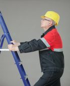Builder climbing on a ladder — Stock Photo