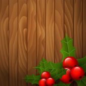 Christmas holly on wooden background — Vettoriale Stock