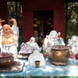 Outdoor shrine with statues of the Laughing Buddha, Hong Kong — Stock Photo #59436785