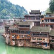 Stilt houses on the Tuojiang River at Fenghuang ancient town, Hunan Province, China — Stock Photo #60690701