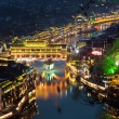 Elevated view of Fenghuang ancient town lit up at night — Stock Photo #60690737