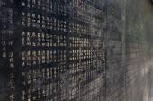 Chinese characters on black wall, Guangzhou, China — Stock Photo