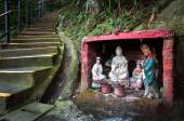 Outdoor shrine containing statues of the Goddess of Mercy and Guan Yu, Hong Kong — Stock Photo