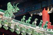Traditonal Chinese roof guardians at the Lama Temple, Beijing — Stock Photo