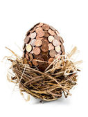 One eurocent egg in bird's nest — Stock Photo