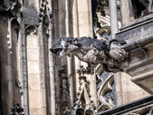 Stone demon gargoyle — Stock Photo