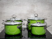 Four stewpots on induction cooker — Stock Photo